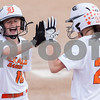 Erik Anderson - For the Daily Chronicle<br /> DeKalb outfielder Morgan Newport yells in celebration as the Barbs score their first run of the game while high-fiving team mate Haley Tadd during the match up of DeKalb and Burlington Central at Dekalb High School on Monday, May 13, 2013. Burlington Central defeated DeKalb 5-3.