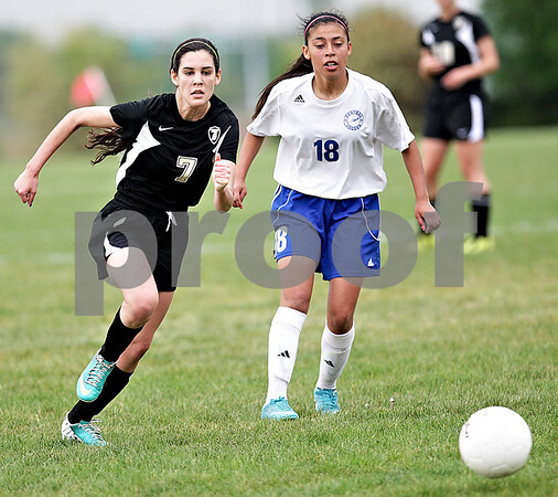 Monica Maschak - mmaschak@shawmedia.com<br /> Janee Carlson makes a sprint for the ball in the Class 2A Sycamore Regional finals against Burlington on Friday, May 17, 2013. The Spartans won 1-0.