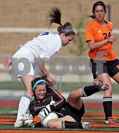 Monica Maschak - mmaschak@shawmedia.com<br /> St. Charles North's Alyssa Brandt collides with DeKalb goalie Maddie Frye in the Class 3A DeKalb Regional semifinals on Wednesday, May 15, 2013. The North Stars beat The Barbs 5-1.