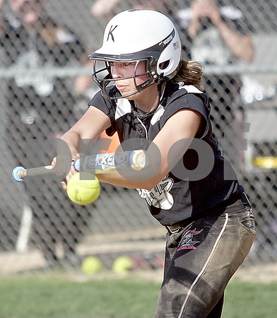 Monica Maschak - mmaschak@shawmedia.com<br /> Lexi Roach bunts the ball in a game against DeKalb on Thursday, May 16, 2013. The Knights shut out the Barbs 4-0.