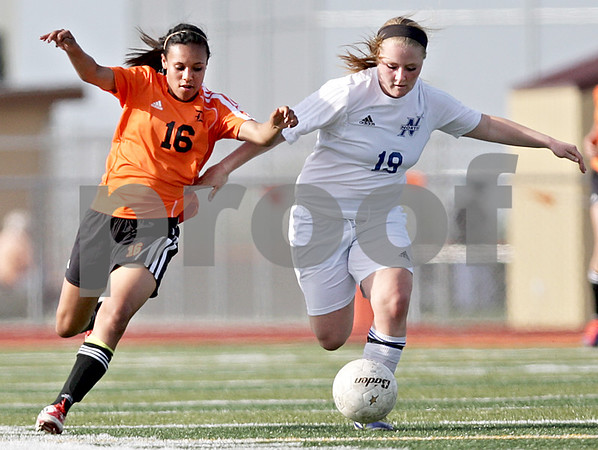Monica Maschak - mmaschak@shawmedia.com<br /> DeKalb's Ayslin Nachman and St. Charles North's Megan O'Leary race for the ball during the Class 3A DeKalb Regional semifinals on Wednesday, May 15, 2013. The North Stars beat The Barbs 5-1.