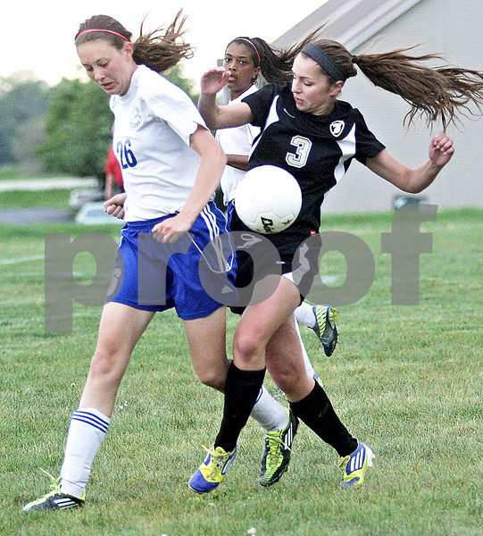 Monica Maschak - mmaschak@shawmedia.com<br /> Amy Schroeder collides with her opponent when attempting to bump the ball in the Class 2A Sycamore Regional finals against Burlington on Friday, May 17, 2013. The Spartans won 1-0.
