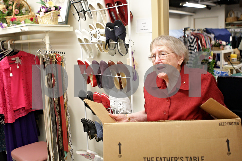 """Rob Winner – rwinner@shawmedia.comRuby Griswold emerges from the back room of the Friends Resale Shop at Barb City Manor in DeKalb, Ill. carrying a box of items for a customer on Thursday, May 9, 2013. Griswold was named Barb City Manor's 2012 """"Volunteer of the Year."""""""