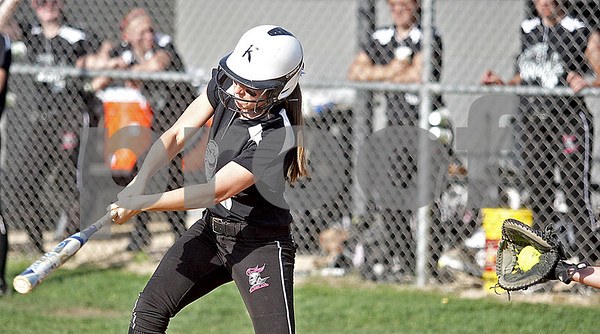 Monica Maschak - mmaschak@shawmedia.com<br /> Morgan Newhouse misses the ball as it hits the catcher's mitt in a game against DeKalb on Thursday, May 16, 2013. The Knights shut out the Barbs 4-0.