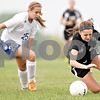 Monica Maschak - mmaschak@shawmedia.com<br /> Amy Schroeder takes a tumble after tripping over her opponent in the Class 2A Sycamore Regional finals against Burlington on Friday, May 17, 2013. The Spartans won 1-0.