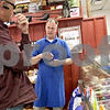 Monica Maschak - mmaschak@shawmedia.com<br /> Country Store and Catering, Inc. Owner Tom Ulrich talks to a customer about the specialty bratwursts made in the Sycamore store. Ulrich offers ready-for-grilling meats, salads, desserts, take-out and dine-in orders.