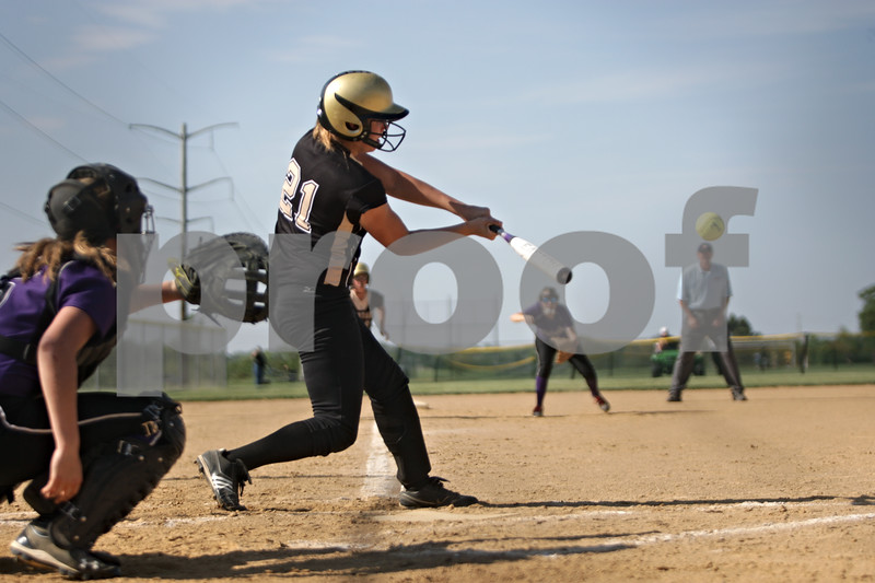 Rob Winner – rwinner@shawmedia.com<br /> <br /> Sycamore batter Brittany Huber (21) connects for a two-run home run in the bottom of the first inning during the Class 3A Sycamore Regional quarterfinals.