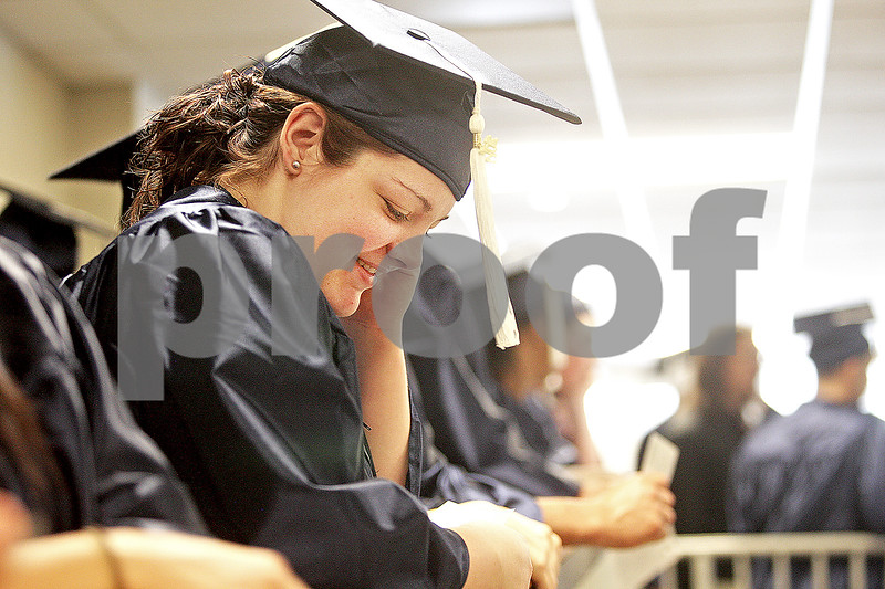 Monica Maschak - mmaschak@shawmedia.com<br /> Melissa Hudson waits for the 2:00 p.m. graduation at Kishwaukee College to begin on Saturday, May 18, 2013. Hudson earned her General Education Development certificate.