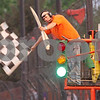"Gary L. Gates for Shaw Media<br /> <br /> Sycamore Speedway Flagman Dave ""Rattle Ballz"" Radloff waves the checkered flag ending a race last Saturday at the Sycamore Speedway in Maple Park.<br /> <br /> Saturday, May 18, 2013<br /> Maple Park, Ill."