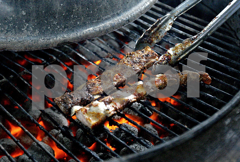 Monica Maschak - mmaschak@shawmedia.com<br /> Country Store and Catering, Inc. in Sycamore offers ready-for-grilling meats, salads, desserts, take-out and dine-in orders. Pictured are rib tips on a grill.