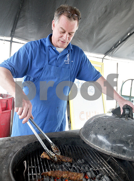 Monica Maschak - mmaschak@shawmedia.com<br /> Country Store and Catering, Inc. Owner Tom Ulrich grills rib tips outside of his store in Sycamore on Thursday, May 23, 2013. Country Store offers ready-for-grilling meats, salads, desserts, take-out and dine-in orders.