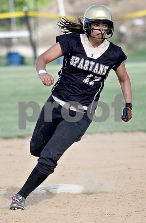 Monica Maschak - mmaschak@shawmedia.com<br /> Jasmyne Taylor rounds second base in the Class 3A Sycamore Regional semifinals against Burlington Central on Tuesday, May 21, 2013. The game was called after six innings when the Spartans were down 11-1.