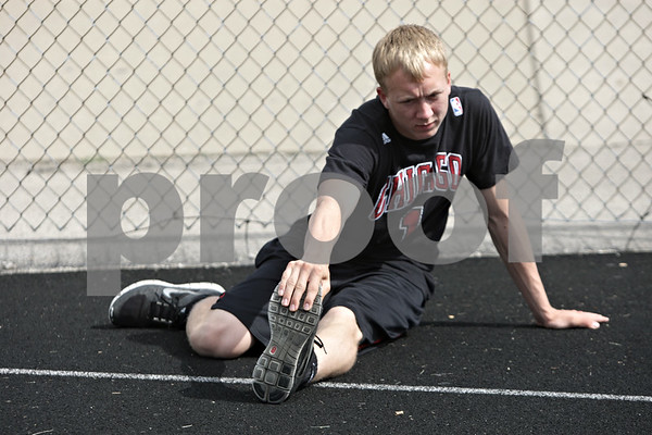 Rob Winner – rwinner@shawmedia.com<br /> <br /> Hinckley-Big Rock's Jared Madden stretches before track practice at Sandwich High School in Sandwich, Ill., Tuesday, May 21, 2013. Madden qualified for the state 300 hurdles.
