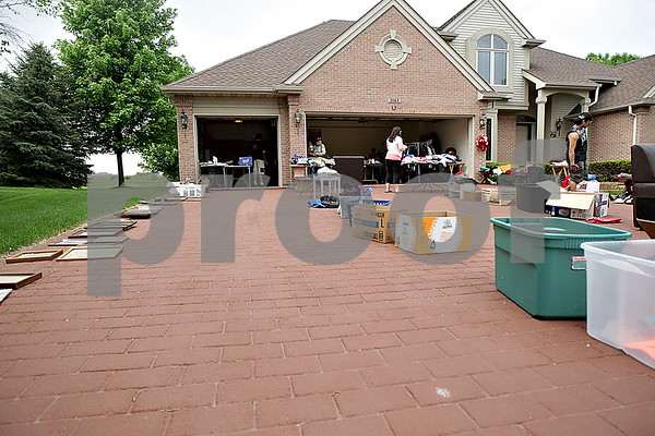 Monica Maschak - mmaschak@shawmedia.com<br /> Owners of this The Bridges of Rivermist home extended their sale items into their driveway during the annual community garage sale in DeKalb on Friday, May 17, 2013.