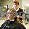 Monica Maschak - mmaschak@shawmedia.com<br /> Amanda Ericson, a senior at Sycamore High School, gets more than eight inches of her hair chopped off at Great Clips in DeKalb on Tuesday, May 21, 2013. Ericson will donate her hair to Pantene Beautiful Lengths, a program similar to Locks of Love, because it doesn't require a cash donation from hair donors and serves a broader range of recipients.