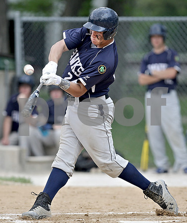 Monica Maschak - mmaschak@shawmedia.com<br /> Will Corn, for Hiawatha, makes a hit in a Class A Hinckley-Big Rock Regional finals game at Kenny Field on Saturday, May 18, 2013. Hiawatha won 6-5.