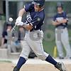 Monica Maschak - mmaschak@shawmedia.com<br /> Will Corn, for Hiawatha, makes a hit in a Class A Hinckley-Big Rock Regional finals game at Kenny Field on Saturday, May 18, 2013. Hiawatha won 6-5.