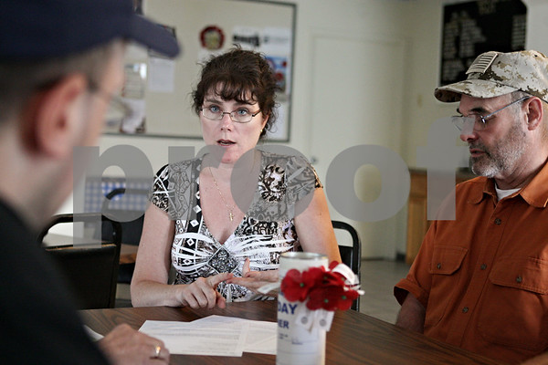 Rob Winner – rwinner@shawmedia.com<br /> <br /> Adjutant Margaret McCann (center) speaks with local veterans including Larry Stichberry (left) and Doug Massier while going over an itinerary of Memorial Day weekend services at the American Legion Post #66 in DeKalb, Ill., Wednesday, May 22, 2013.