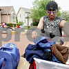 Monica Maschak - mmaschak@shawmedia.com<br /> Omar Barz sifts through a bin of winter hats and scarves at the annual community garage sale at The Bridges of Rivermist in DeKalb on Friday, May 17, 2013. This residence used this opportunity to have their moving sale.