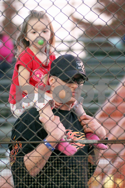 Gary L. Gates for Shaw Media<br /> <br /> Jason Hill and his daughter Sophia, 2, of Crystal Lake, watch as cars enter the track during last Saturday's races at the Sycamore Speedway in Maple Park.<br /> <br /> Saturday, May 18, 2013<br /> Maple Park, Ill.