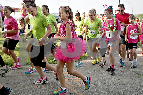 """Monica Maschak - mmaschak@shawmedia.com<br /> About 111 girls, their running buddies and community members took off on the area's first Girls on the Run 5K race at Hopkins Park at 8:30 a.m. on Saturday, May 18, 2013. Girls on the Run is a national program that encourages girls in grades 3-5 to avoid gossiping and bullying and promotes making better, heathier decisions. The back of the runners' shirts read, """"I am strong. I am beautiful. I am worth it."""""""