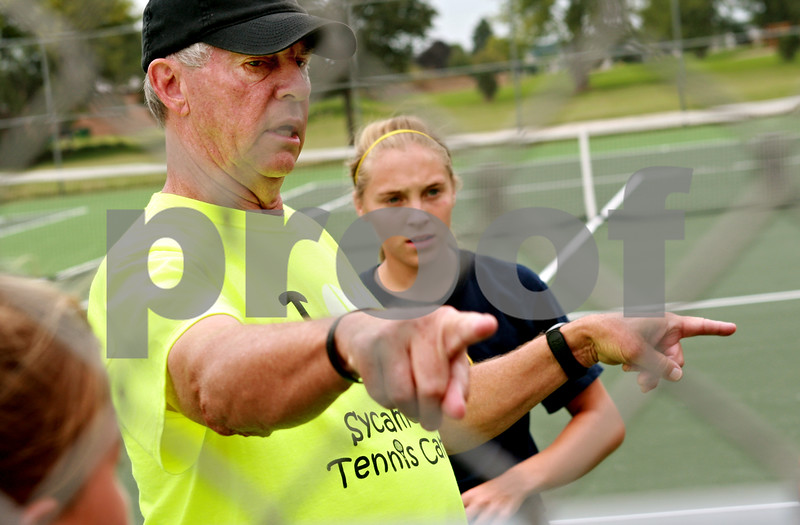 Beck Diefenbach - bdiefenbach@daily-chronicle.com<br /> <br /> Sycamore's girls tennis head coach Dave Hillmer leads varsity practice at Sycamore High School in Sycamore, Ill., on Tuesday Aug. 17, 2010.