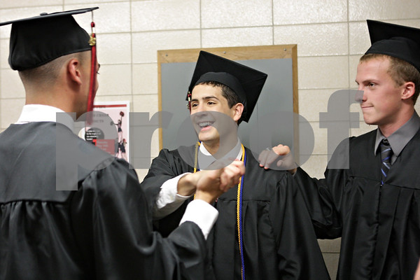 Rob Winner – rwinner@shawmedia.com<br /> <br /> (From left to right) Aaron Bolton, Carlos Sanchez and Jake Gullstrand gather outside the gymnasium before their graduation ceremony at Indian Creek High School in Shabbona, Ill., Sunday, May 19, 2013.