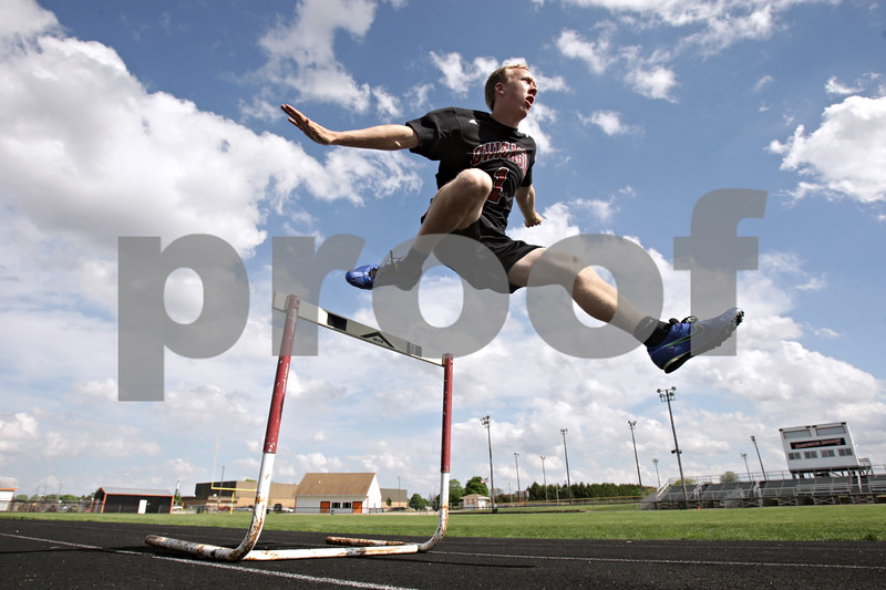 Rob Winner – rwinner@shawmedia.com<br /> <br /> Hinckley-Big Rock's Jared Madden practices leaping over a hurdle at Sandwich High School in Sandwich, Ill., Tuesday, May 21, 2013. Madden qualified for the state 300 hurdles.