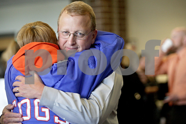Monica Maschak - mmaschak@shawmedia.com<br /> Don Billington hugs a guest during an open house at Genoa-Kingston High School to congratulate Billington on his retirement after 22 years as principal on Thursday, May 23, 2013.