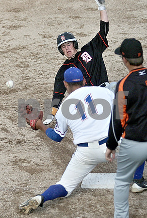 Monica Maschak - mmaschak@shawmedia.com<br /> DeKalb's Danny Petras attempts to slide into third base before the ball during the Class 4A DeKalb Regional semifinals on Thursday, May 23, 2013. The Chargers shut out the Barbs 10-0 after six innings.
