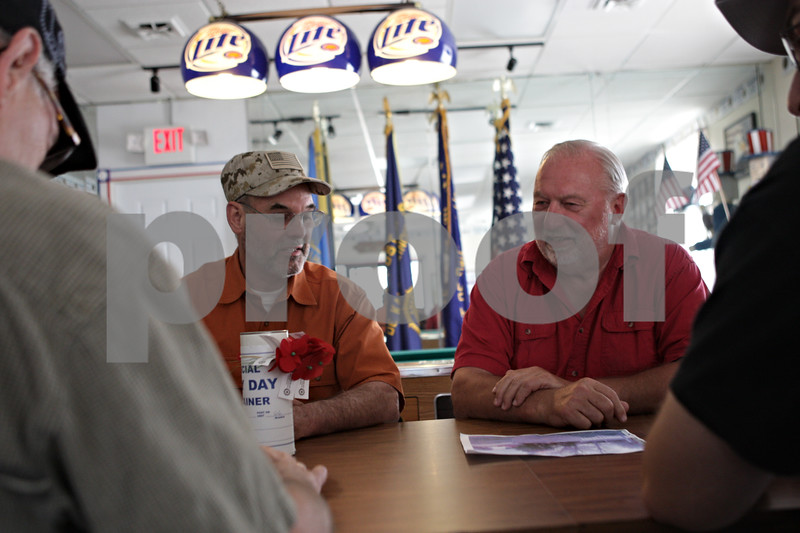 Rob Winner – rwinner@shawmedia.com<br /> <br /> Local veterans including Doug Massier (left), of DeKalb, and Ken Andersen, of Sycamore, discuss plans for Memorial Day weekend services at the American Legion Post #66 in DeKalb, Ill., Wednesday, May 22, 2013.