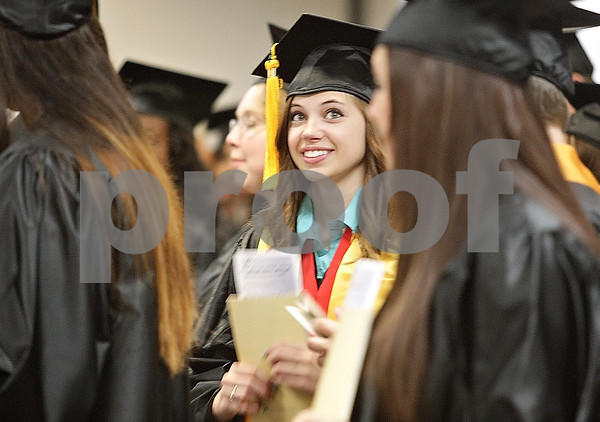 Monica Maschak - mmaschak@shawmedia.com<br /> Carly Hoecherl looks up in excitement as her and her peers are about to file into their 2:00 p.m. graduation ceremony at Kishwaukee College on Saturday, May 18, 2013. Hoecherl earned an Associates in Arts degree.