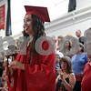 Rob Winner – rwinner@shawmedia.com<br /> <br /> Graduating senior Riley Ryburn makes a funny face after entering the gymnasium for Indian Creek's commencement in Shabbona, Ill., Sunday, May 19, 2013.