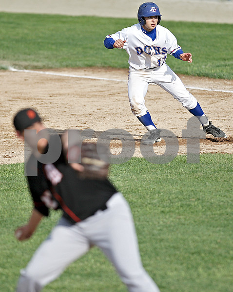 Monica Maschak - mmaschak@shawmedia.com<br /> Dundee-Crown's Zach Girard inches off first base during the Class 4A DeKalb Regional semifinals on Thursday, May 23, 2013. The Chargers shut out the Barbs 10-0 after six innings.