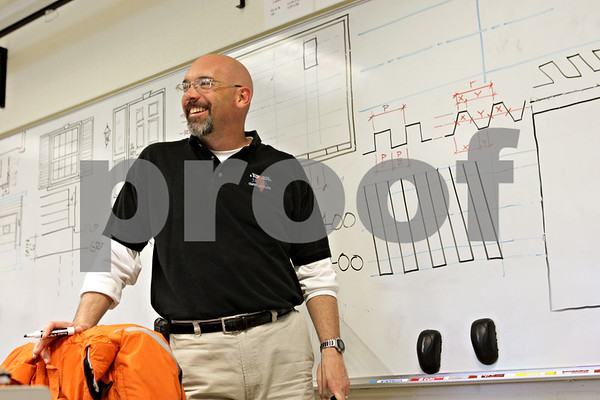 Rob Winner – rwinner@shawmedia.com<br /> <br /> Phil Jerbi instructs a drafting class at Genoa-Kingston High School on Wednesday, April 24, 2013.<br /> <br /> Genoa, Ill.