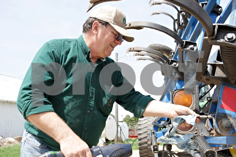 Rob Winner – rwinner@shawmedia.com<br /> <br /> Paul Taylor of Esmond, Ill. prepares some field machinery on his farm on Tuesday, April 30, 2013.