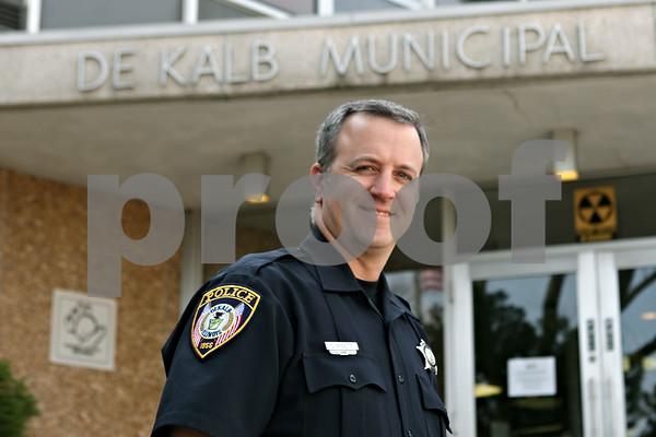 Rob Winner – rwinner@shawmedia.com<br /> <br /> Chad McNett, Community Relations Officer and Training Coordinator of the DeKalb Police Department, is seen outside the DeKalb Municipal Building in DeKalb, Ill., Thursday, May 2, 2013.