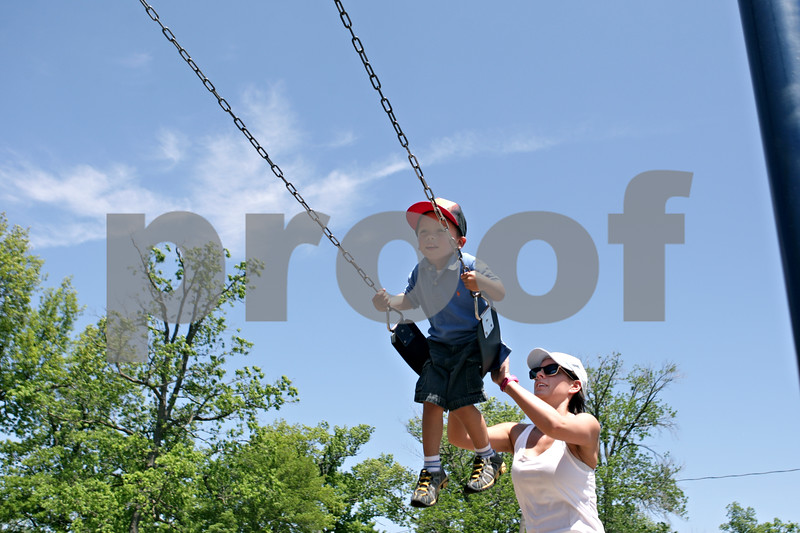 Rob Winner – rwinner@shawmedia.com<br /> <br /> Madden Sykes, 3, is pushed by his mother, Maggie Seeley, of DeKalb, while on a swing in the playground area of Hopkins Park in DeKalb, Ill., Monday, May 20, 2013. <br /> <br /> ***Add text about today's weather?***