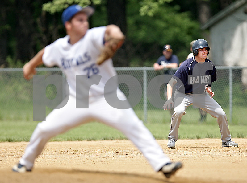 Monica Maschak - mmaschak@shawmedia.com<br /> Hiawatha's Donald Giebel inches off first base in anticipation of moving to second base in a Class A Hinckley-Big Rock Regional finals game at Kenny Field on Saturday, May 18, 2013. Hiawatha won 6-5.