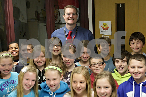 Rob Winner – rwinner@shawmedia.com<br /> <br /> Southeast Elementary School principal Mark Ekstrom and a group of fifth graders as seen on Friday, April 26, 2013, in Sycamore, Ill.