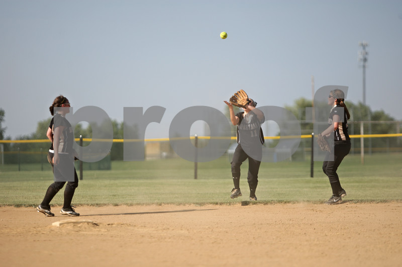 Rob Winner – rwinner@shawmedia.com<br /> <br /> Sycamore center fielder Lyndsey Coddington (11) gets under a ball before catching it in the top of the second inning during the Class 3A Sycamore Regional quarterfinals.