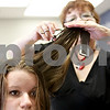 Monica Maschak - mmaschak@shawmedia.com<br /> Amanda Ericson, a senior at Sycamore High School, gets her hair styled by Martha Villavicencio after chopping off more than eight inches of her hair at Great Clips in DeKalb on Tuesday, May 21, 2013. Ericson will donate her hair to Pantene Beautiful Lengths, a program similar to Locks of Love, because it doesn't require a cash donation from hair donors and serves a broader range of recipients.