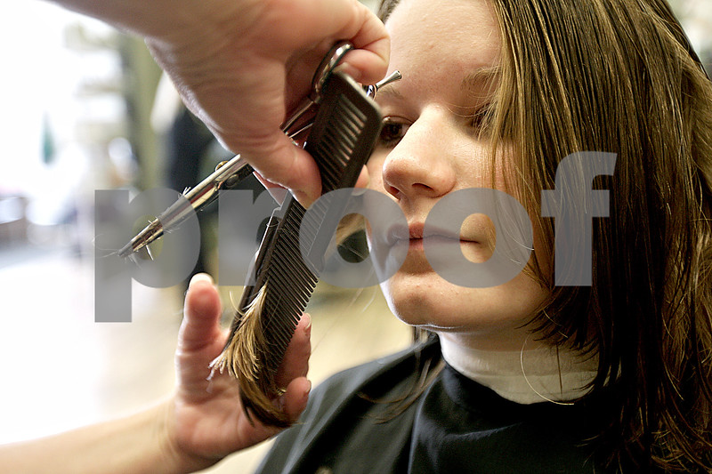 Monica Maschak - mmaschak@shawmedia.com<br /> Amanda Ericson, a senior at Sycamore High School, gets her hair styled after chopping off more than eight inches of her hair at Great Clips in DeKalb on Tuesday, May 21, 2013. Ericson will donate her hair to Pantene Beautiful Lengths, a program similar to Locks of Love, because it doesn't require a cash donation from hair donors and serves a broader range of recipients.
