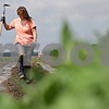 Rob Winner – rwinner@shawmedia.com<br /> <br /> Barb Pondelick, of Sycamore, uses a garden hoe to mark where to plant vegetable plants at her parents' farm in Maple Park, Ill., Tuesday, May 21, 2013. The family owned Theis Farm II sells their produce at a farmers market in Aurora.