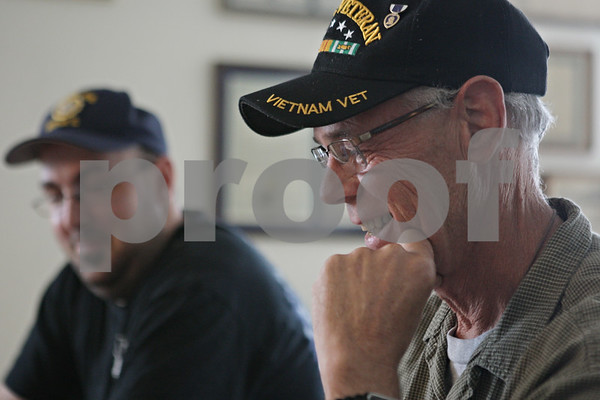 Rob Winner – rwinner@shawmedia.com<br /> <br /> U.S. Marine veteran Jerry Johnson, of Cortland, cracks a smile as a group of local veterans met at the American Legion Post #66 in DeKalb to discuss plans for Memorial Day weekend services on Wednesday, May 22, 2013.