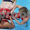 Monica Maschak - mmaschak@shawmedia.com<br /> Hopkins pool lifeguards Elise Pollack (left) and Lindsey Blakley (right) practice a backboarding drill on fellow lifeguard Mike Lee during a recertification process at the Hopkins pool in DeKalb on Thursday, May 30, 2013.