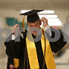 Rob Winner – rwinner@shawmedia.com<br /> <br /> Scott Nelson heads back to his homeroom to join his classmates before the start of commencement on Sunday at Sycamore High School.
