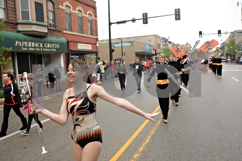 Rob Winner – rwinner@shawmedia.com<br /> <br /> Baton twirler Allison Hunter-Rosene leads the DeKalb High School marching band west on Lincoln Highway during Monday's Memorial Day parade in downtown DeKalb, Ill.<br /> <br /> Monday, May 27, 2013