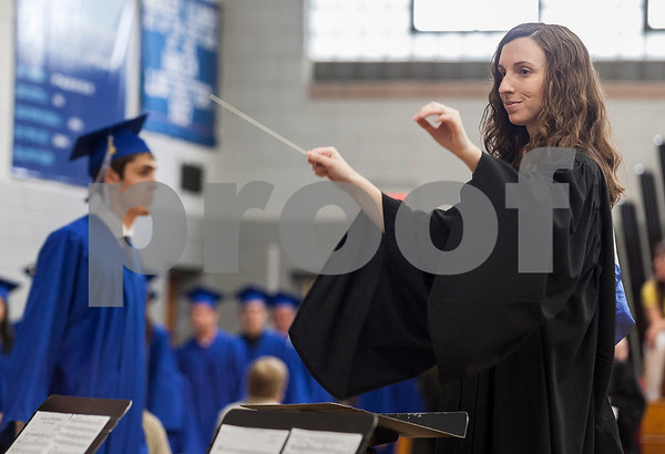 Erik Anderson - For the Daily Chronicle<br /> Lauren Dunteman conducts the processional music as graduates walk down the main aisle during Hinckley-Big Rock's graduation ceremony at Hinckley-Big Rock High School in Hinckley on Sunday, May 26, 2013.