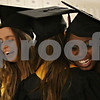 Rob Winner – rwinner@shawmedia.com<br /> <br /> Seniors Jannah Puskar (from left to right), Leyla Puskar and Brianna Hopkins embrace before commencement at Sycamore High School on Sunday afternoon.
